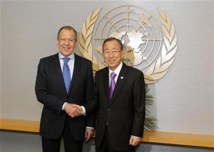 U.N. Secretary-General Ban shakes hands with Russia's Foreign Minister Lavrov as they pose for a photograph at the U.N. headquarters in New York